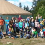 Youth in front of the yurt